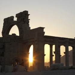 The sun sets behind ruined columns at the historical city of Palmyra, in the Syrian desert, some 150 miles northeast of the capital of Damascus. Reuters