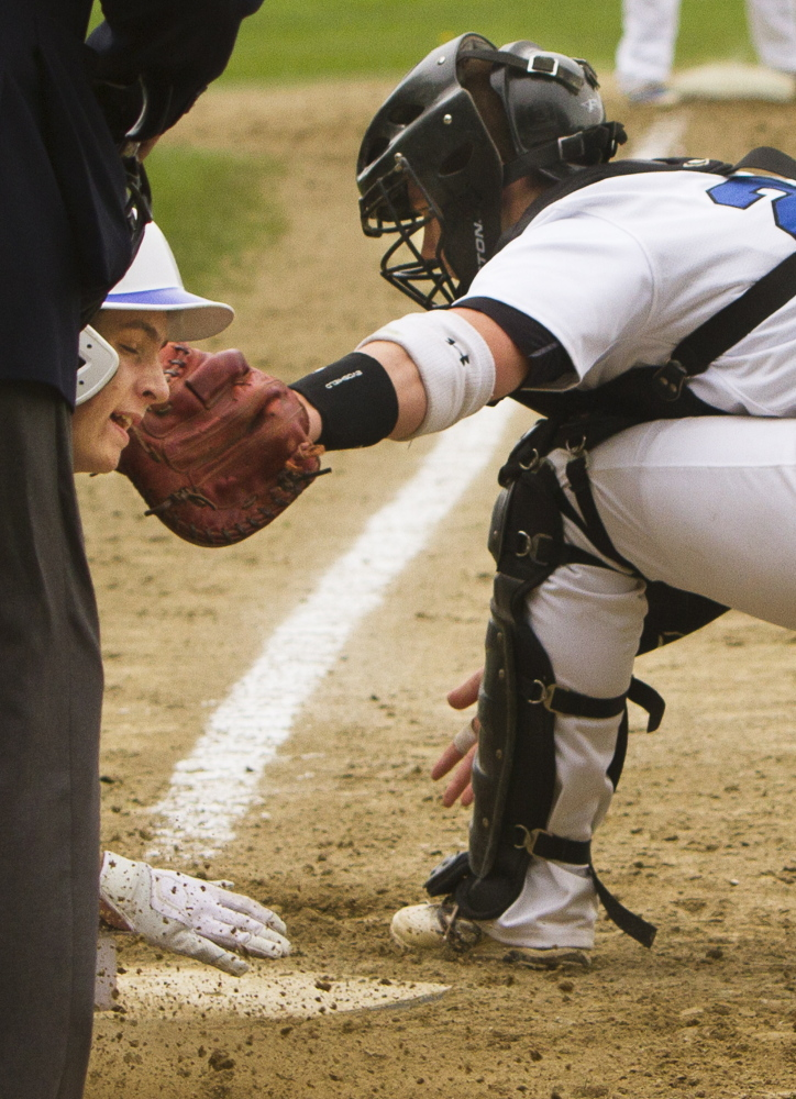 Kennebunk catcher Kip Richard stretches but Robbie Armitage of Falmouth beats the tag and slides safely into the plate during Falmouth's 8-2 victory Saturday.