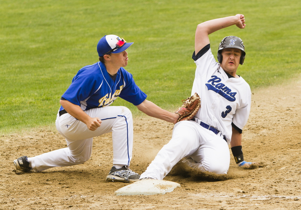 Falmouth first baseman Colby Emmertz doubles up Kennebunk baserunner Sam Heikinen as he attempts to get back to the base Saturday.
