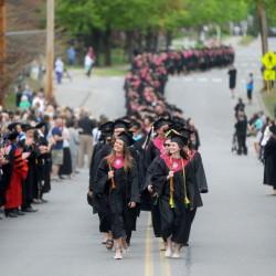 University of Maine at Farmington's class of 2015 marches down High Street to begin commencement ceremonies in Farmington on Saturday.