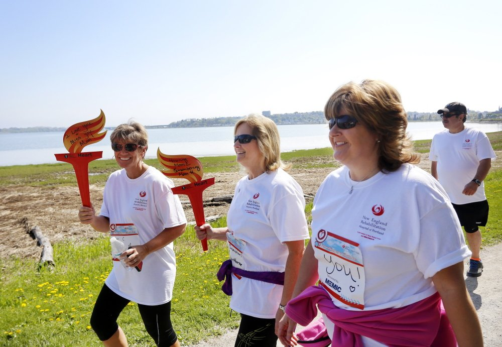 Participants in the Southern Maine Heart Walk around Back Cove on Sunday included, from left: Lisa Desmarteau of West Palm Beach, Fla., walking in honor of her mother who died last year of a heart attack; Jeanine Chesley of Gorham, in honor of her mother who has had two heart attacks; and Pam Forbes of Orono, walking to support her friends.