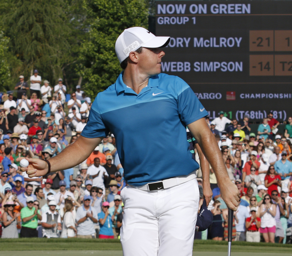 Rory McIlroy celebrates his win Sunday at the Wells Fargo Championship by throwing his golf ball into the crowd of fans around the 18th hole. McIlroy cruised to his second straight PGA Tour victory, winning by seven strokes.