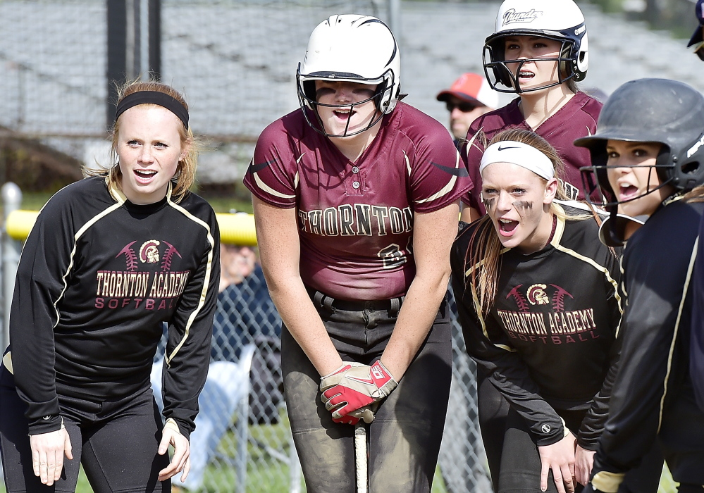 Thornton teammates cheer a home run by Libby Pomerlau in the third inning of the Trojans' 8-2 softball win over McAuley on Monday.