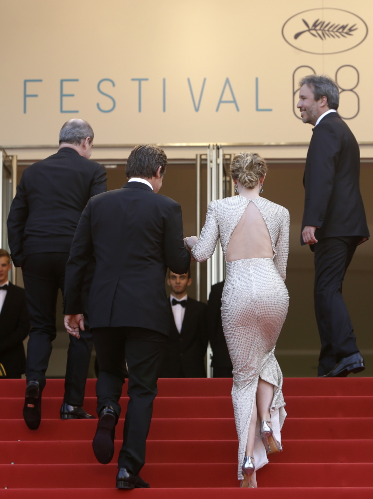 From left, festival president Pierre Lescure, actors Josh Brolin, Emily Blunt and director Denis Villeneuve for the screening of the film Sicario at the 68th international film festival, Cannes, southern France, Tuesday, May 19, 2015. (AP Photo/Lionel Cironneau)