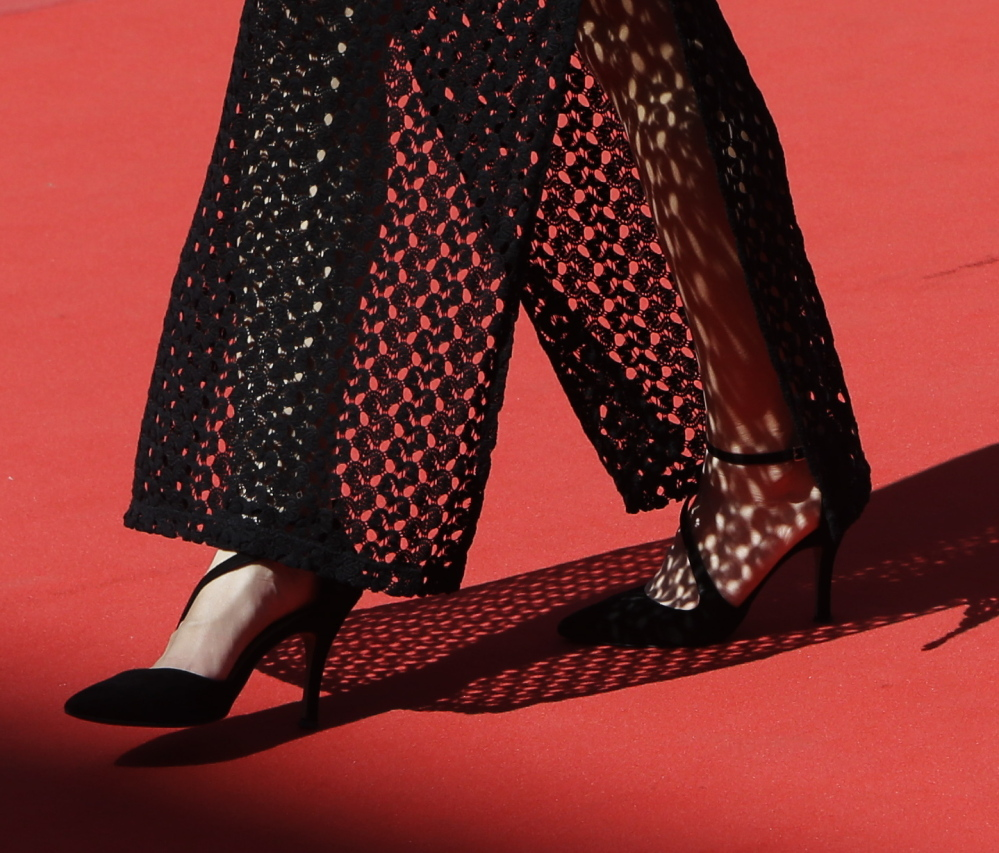 An guest wearing high heels walks on the red carpet at the Cannes Film Festival in France. Women wearing flats were turned away.