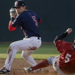 Carlos Asuaje of Portland looks toward first, but holds the ball after forcing out Altoona's Max Moroff in Tuesday's game at Hadlock Field. Asuaje went 3 for 5 as the Dogs rallied for a 14-10 win.