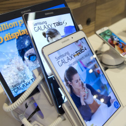 Samsung Galaxy tablets are displayed at an AT&T company store in New York. AT&T is revamping its stores to showcase services such unlocking doors with an app.