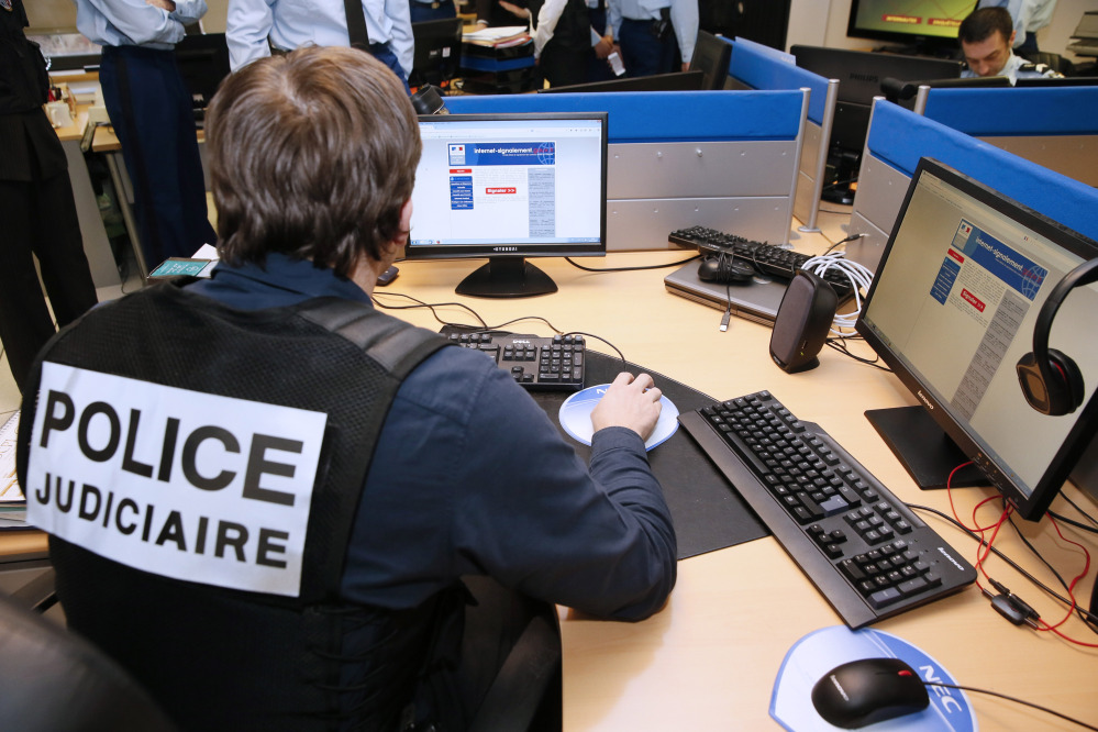 A French police officer works at the headquarters of the Pharos reporting platform against cyber criminality, in Nanterre, outside Paris. Fearful of an expanding extremist threat, countries that for years have relied heavily on U.S. intelligence are quickly building up their own capabilities.
