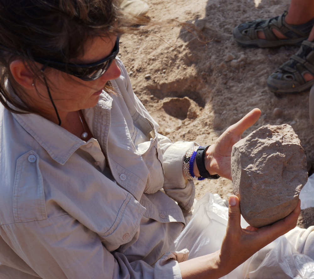 Sonia Harmand holds a stone tool found in the West Turkana area of Kenya. It is unknown who made the tools and why, but scientists believe they were made by forerunners of homo sapiens. The Associated Press
