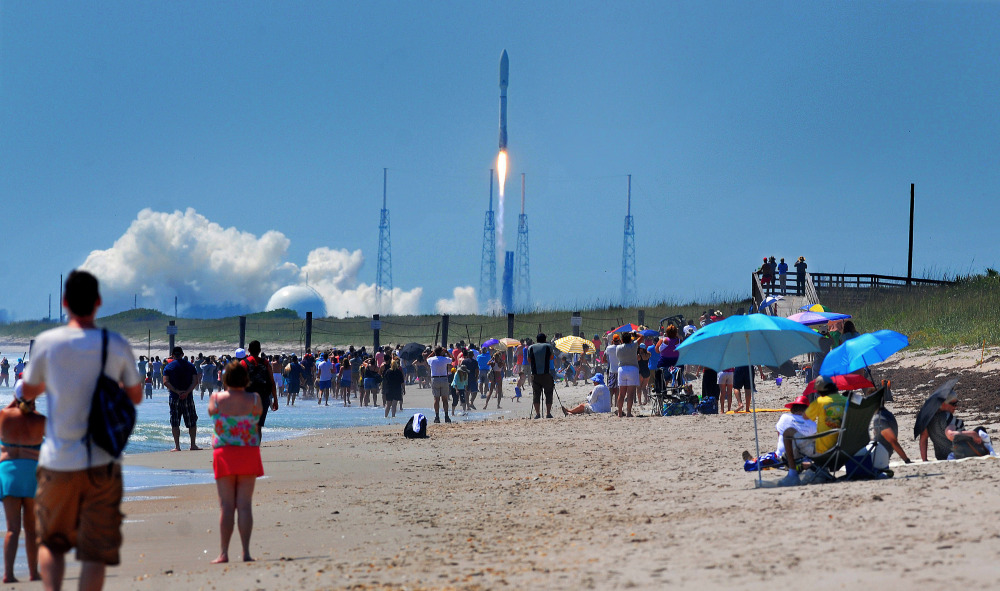 People on the Canaveral National Seashore watch a United Launch Alliance Atlas V rocket lift off from Cape Canaveral Air Force Station in Cape Canaveral, Fla. on Wednesday. The rocket is carrying the X-37B space plane for the U.S. Air Force as well as 10 CubeSats and the Planetary Society's LightSail Mission. Craig Rubadoux/Florida Today via AP
