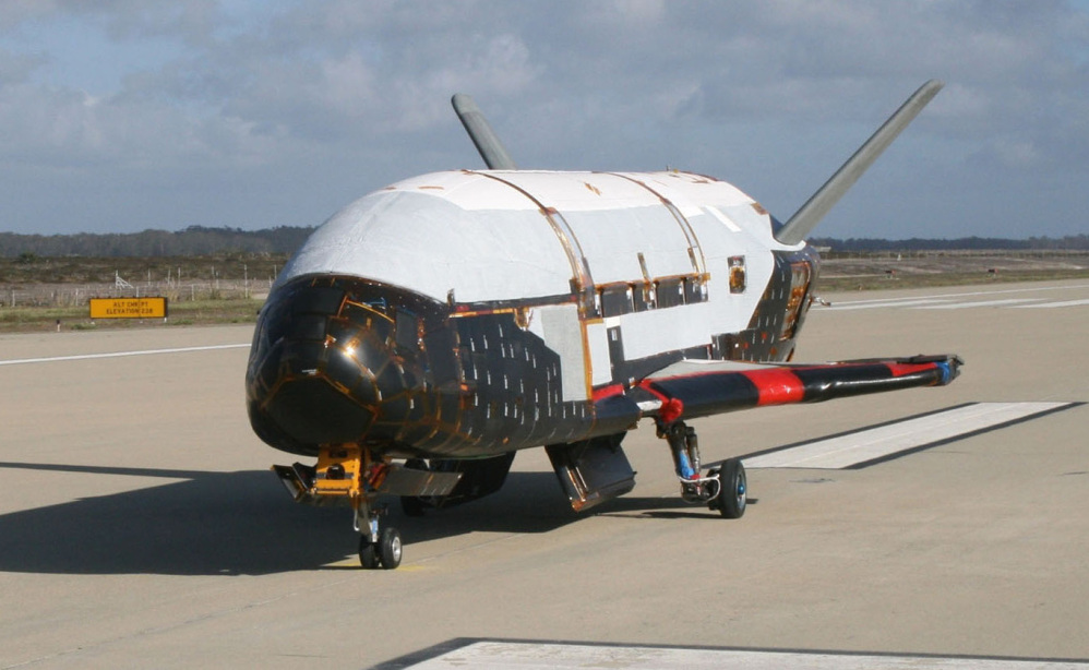 The unmanned X-37B looks like a miniature NASA space shuttle and launches vertically and lands horizontally. But no one flies aboard the spacecraft.