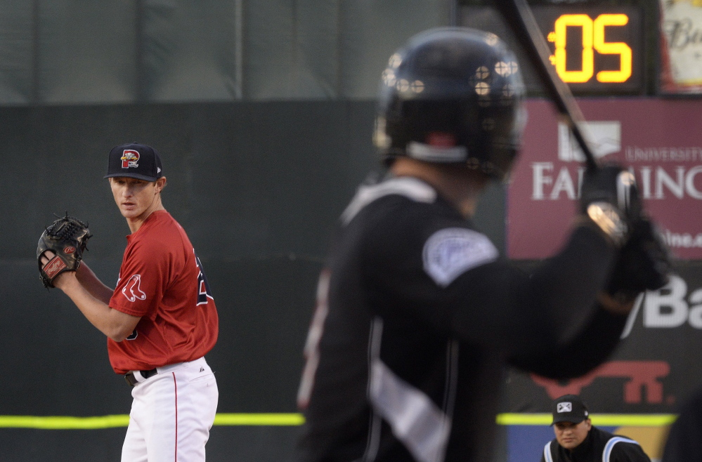 Mike McCarthy of the Sea Dogs prepares to throw as the pitch clock winds down at Hadlock Field in a game in 2015. Minor-league baseball has had success with the 20-second clocks, and Major League Baseball should use them as one way to speed up games.