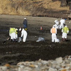 Cleanup crews remove oil-laden sand on the beach at Refugio State Beach, site of an oil spill, north of Goleta, Calif., on Wednesday.