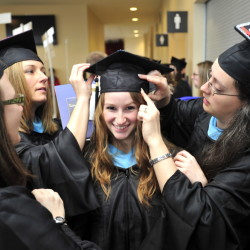 Sarah Quint of Wells, center, Krista Chamberlain of Buxton, second from left, and Melissa Adams of Biddeford, prepare for graduation from USM at the Cumberland County Civic Center on May 10. A recent survey found that only 12 percent of new graduates have definite plans. They are all getting a Masters in Teaching and Learning.