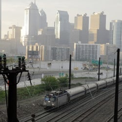 An Amtrak train travels north from 30th Street Station in Philadelphia. Amtrak's Northeast Corridor trains resumed service Monday.