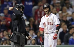 Boston's Dustin Pedroia argues a called third strike with home plate umpire Mark Wegner after striking out against Texas Rangers relief pitcher Keone Kela in the eighth inning of Thursday night's 3-1 loss.