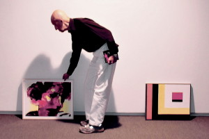 "Alex Katz arranges works for ""An Artist's Gift"" at the Colby College Museum of Art in Waterville."