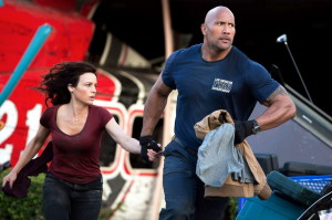 "Carla Gugino and The Rock in ""San Andreas."""