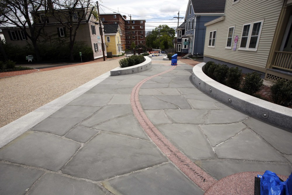 Winding through the center of the African Burying Ground Memorial Park in Portsmouth, N.H., are paving stones etched with phrases from an unsuccessful petition submitted by slaves to the New Hampshire Legislature in 1779 asking for freedom. In 2013, Gov. Maggie Hassan granted the petitioners posthumous emancipation.