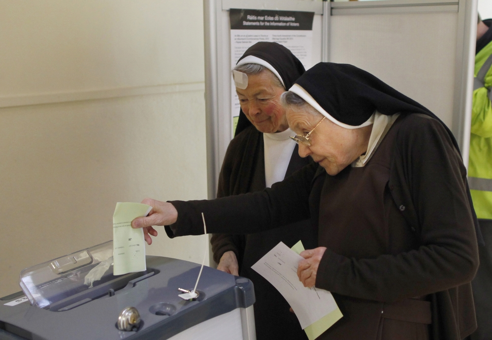 Carmelite sisters cast their vote at a polling station in Malahide, County Dublin, Ireland, on Friday.