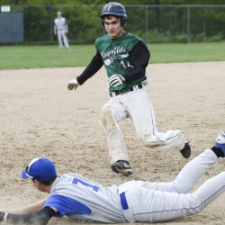 Third baseman Brian Davis of Old Orchard Beach dives for the bag and records the out Friday as Jacob Hagler of Waynflete begins his slide during Old Orchard's 17-4 victory at Fore River Field in Portland.