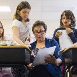 "Foster Grandparent Fran Seeley helps third-graders, from left, Alexus Chapman, Charlotte Libby, Lucy Tidd and Donald Enman with math at Lyseth Elementary School in Portland on Tuesday. ""Sometimes with math I get a little bit like I don't believe in myself, but now I feel like I'm getting better,"" Charlotte said."