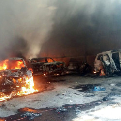 Vehicles burn after a gunbattle at Rancho del Sol, near Ecuanduero, in western Mexico, on Friday.