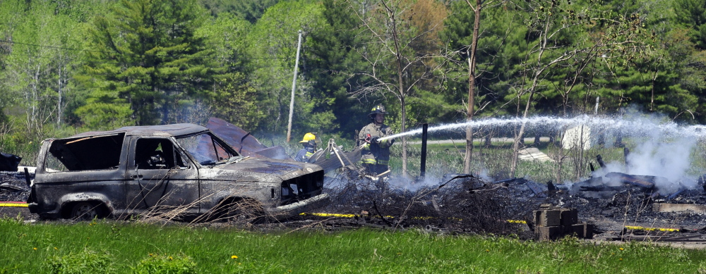 Firefighters work at the scene of a fire that destroyed a chicken barn Saturday in Pittston. Joe Phelan/Kennebec Journal