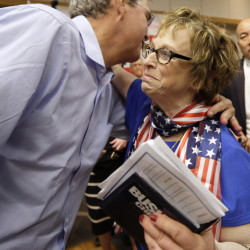 Former Florida Gov. Jeb Bush gets a hug from a supporter after a town hall meeting May 16 in Dubuque, Iowa. Some Iowa Republicans wonder if he could beat Hillary Clinton in 2016.