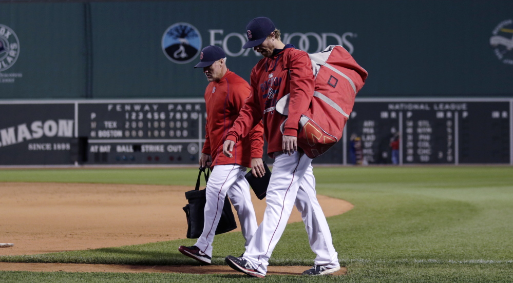 Mike Brenly, foreground, walking to the Fenway Park dugout with bullpen coach Dana LeVangie, reached the crossroads most minor leaguers reach – whether to keep playing or move on. When the Red Sox offered Brenly the chance to become a bullpen catcher, he took it.