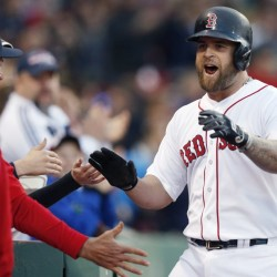 Mike Napoli is welcomed back to the dugout Saturday night after hitting a home run for the Boston Red Sox in the second inning of an 8-3 victory against the Los Angeles Angels. Napoli homered twice.