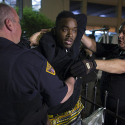 A demonstrator is arrested during a protest against the acquittal of Michael Brelo, a patrolman charged in the shooting deaths of two unarmed suspects, Saturday in Cleveland. The Associated Press