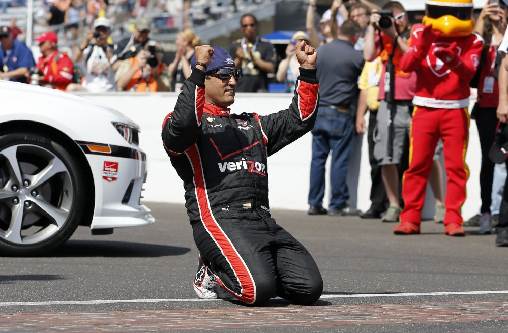 Juan Pablo Montoya of Colombia celebrates after winning the 99th running of the Indianapolis 500 on Sunday. The Associated Press