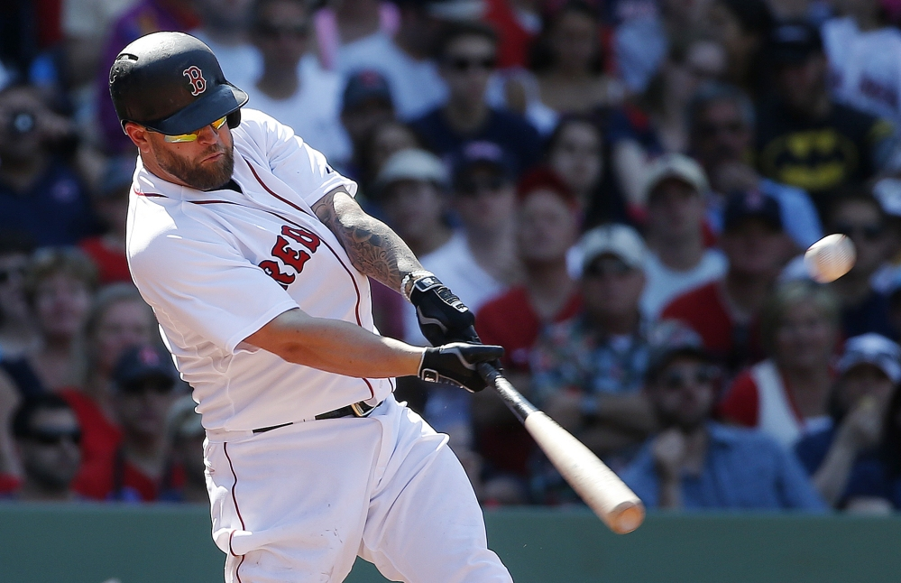Boston's Mike Napoli hits a two-run double in the eighth inning of the Red Sox 6-1 win over the Angels on Sunday in Boston. Napoli also hit a two-run homer run for Boston. The Associated Press