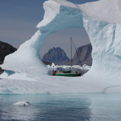 The research vessel Gambo, captained by Nolwenn Chauché, is seen through an iceberg in Uummannaq Bay in Greenland in a 2013 photo.