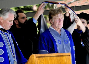 Actor Robert Redford receives an honorary doctor of fine arts degree from Colby College on Sunday.