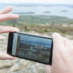 Kerry Gallivan, a co-founder and the CEO of Chimani, uses his Chimani app to locate features of Acadia National Park while standing atop Cadillac Mountain. The app remains fully functional even in areas with no phone or data connectivity.