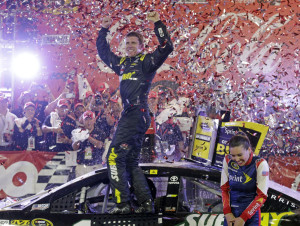Carl Edwards celebrates Sunday night after winning the Coca-Cola 600 at Charlotte Motor Speedway. The victory was the first for Edwards since he joined Joe Gibbs Racing.