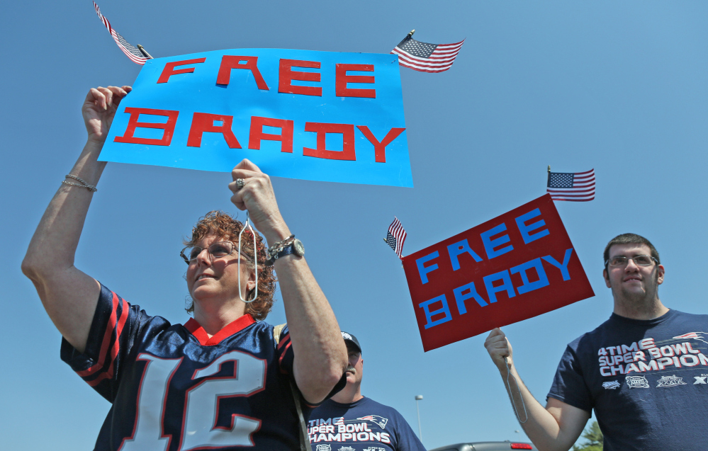 Doreen Domina of Enfield, Conn., and her son, Jacob, take part in a rally Sunday at Gillette Stadium in support of suspended Patriots quarterback Tom Brady.