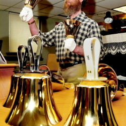 Jon Loekle rings the large bass bells during a practice with other members of the Over the River Ringers handbell group recently.