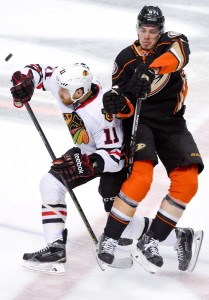 Andrew Desjardins, left, of Chicago checks Anaheim's Rickard Rakell during Game 5 of the Western Conference finals Monday in Anaheim, Calif. The Ducks scored in overtime to win 5-4.