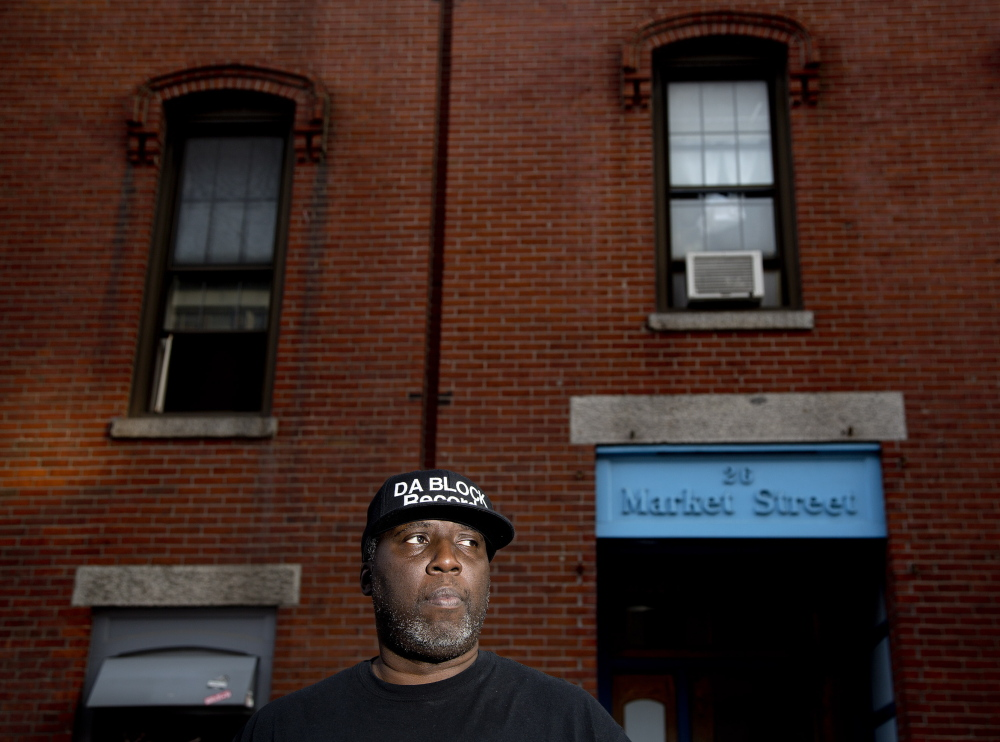 """Ron Hargrove, owner of Da Block Records, stands Tuesday outside 26 Market St., which houses his studio. He says people often use the space at night, but he never had trouble before Monday's shootings. """"The only thing going on in that studio is music."""""""