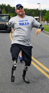 Travis Mills participates in the Miles for Mills 5K on Monday. Mills runs a nonprofit group that helps wounded veterans.