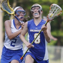 London Bernier of Falmouth controls the ball Tuesday night as Hallie Schwartzman of Kennebunk applies pressure during Falmouth's 10-8 victory that sent Kennebunk to its first girls' lacrosse loss of the season.
