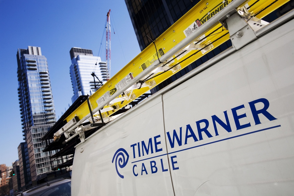 A Time Warner Cable truck in New York. Charter Communications is close to buying Time Warner Cable for about $55 billion. (File photo/The Associated Press)