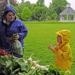 Christine Leavitt, left, and Rylee Lefebvre shop at the farmers market in Gardiner. Grant money aims to encourage food stamp recipients to purchase locally grown foods.