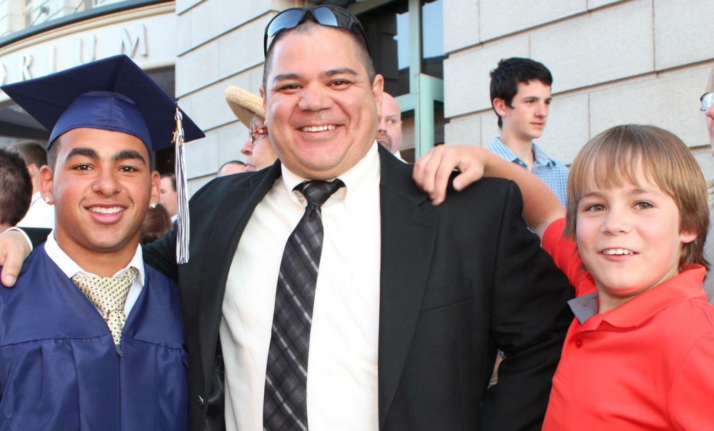From left, Treyjon Arsenault, his stepfather, Donald Laxson, and Treyjon's brother Ashton Laxson are photographed in 2014 at Arsenault's graduation from Westbrook High School.