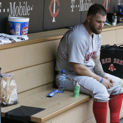 Boston's Mike Napoli sits alone in the dugout after a May 27 loss to the Minnesota Twins.