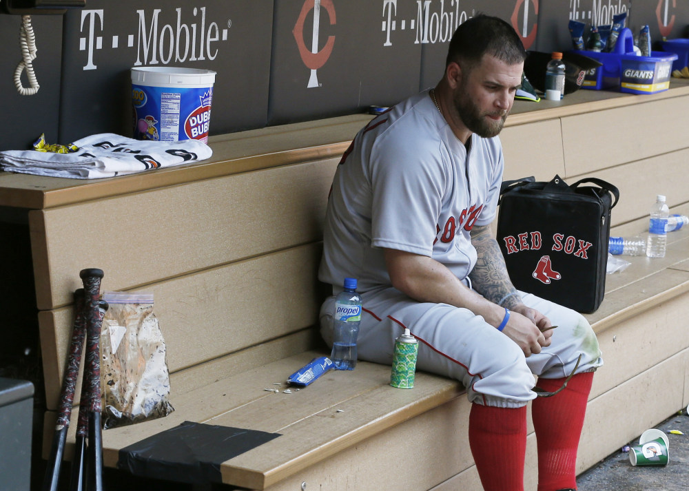 Boston's Mike Napoli sits alone in the dugout after Wednesday's 6-4 loss to the Minnesota Twins. The Twins swept the three-game series.