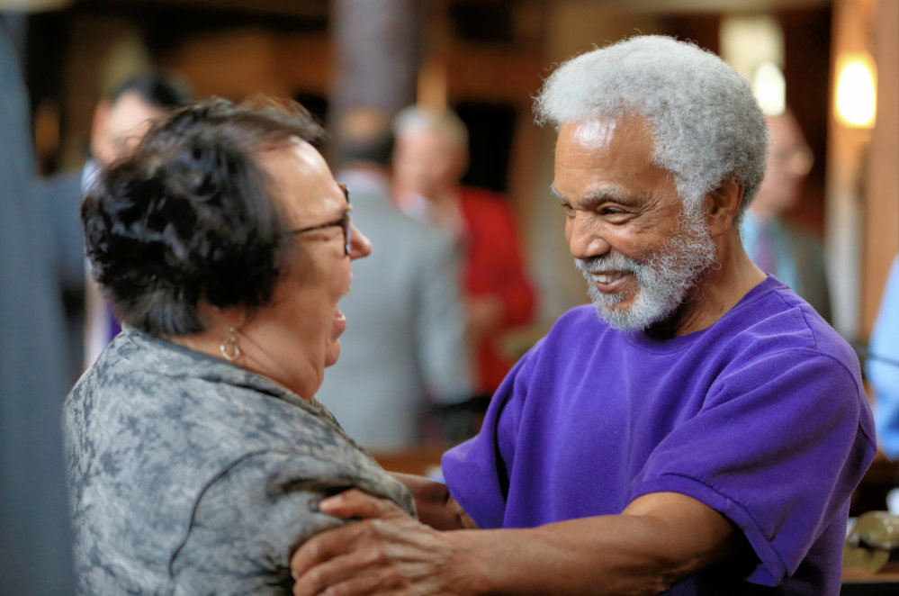 Nebraska state Sen. Ernie Chambers celebrates with Sen. Kathy Campbell after the state's Legislature voted 30-19 to override Gov. Pete Ricketts, a Republican who supports the death penalty. The vote makes Nebraska the first traditionally conservative state to eliminate the punishment since North Dakota in 1973.
